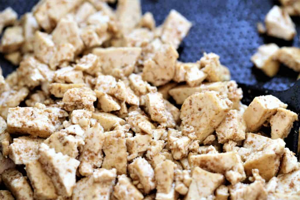 Stirfry tofu with cumin, coriander and salt in sesame oil